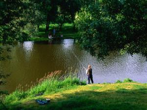 Fishing in the River Vienne, Chinon, France by Diana Mayfield