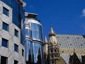 """Gothic Stephansdom (St Stephen's Cathedral) and Hans Hollein's """"Haas Haus,"""" Vienna, Austria by Diana Mayfield"""