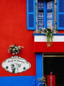 Supermarket Facade, Loctudy, Brittany, France by Diana Mayfield