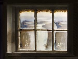 Ceramic Vases Behind Window by Diane Miller