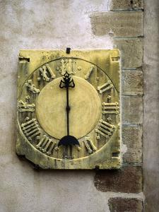 Old Stone Clock on Wall of Old Building by Diane Miller