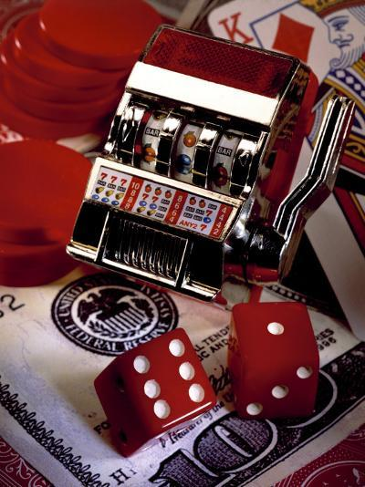 Dice, Slot Machine, Chips and Card on $100 Bill-Ellen Kamp-Photographic Print