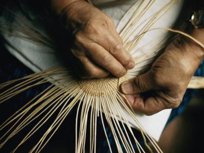 Close View of the Hands of a Hupa Indian Weaving a Basket by Dick Durrance