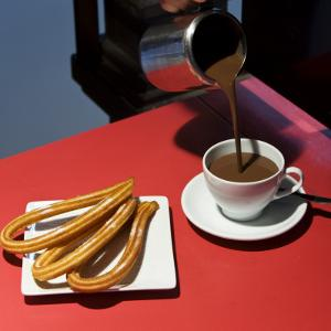Chocolate Con Churros at the San Miguel Market by Diego Lezama