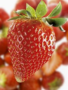 A Strawberry in the Foreground, Lots of Strawberries Behind by Dieter Heinemann