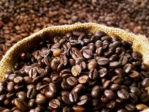 Coffee Beans, Some in a Sack by Dieter Heinemann