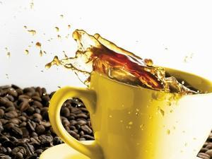 Coffee Spilling Out of a Cup by Dieter Heinemann