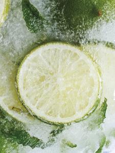 Limes in Block of Ice by Dieter Heinemann