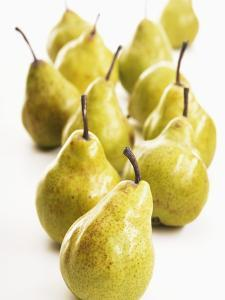 Several Pears Standing One Behind the Other by Dieter Heinemann