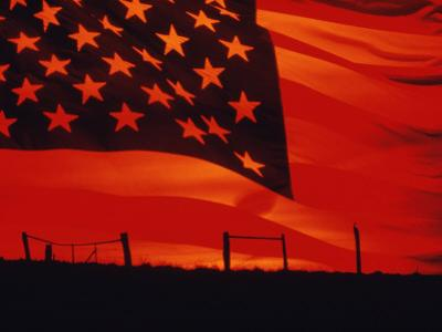Digital Composite of the American Flag over the Countryside