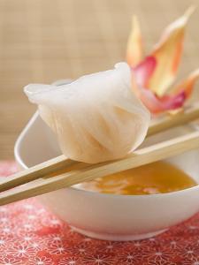 Dim Sum on Chopsticks over Dip (Asia)