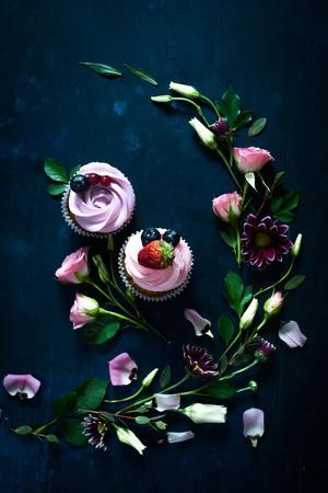Sweet Cupcakes on Dark Wooden