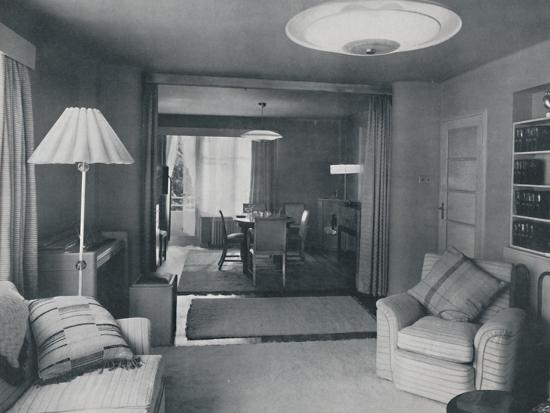 'Dining and living room, divided only by heavy curtains in an attractive modern weave', 1942-Unknown-Photographic Print
