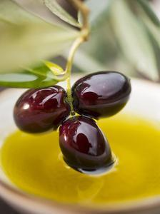Dipping Olive Sprig with Black Olives in Olive Oil