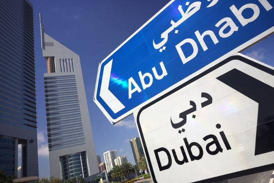 Direction Signs on Sheikh Zayed Road in Dubai-Jon Hicks-Photographic Print