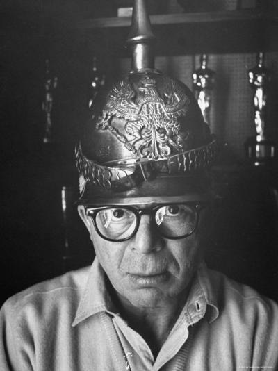 Director Billy Wilder in His Hollywood Office Wearing German Helmet-Gjon Mili-Premium Photographic Print