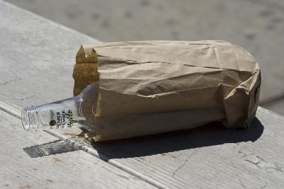 Discarded Rum Bottle In Paper Bag-Mark Williamson-Photographic Print
