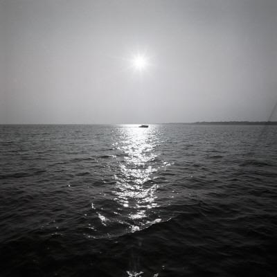 https://imgc.artprintimages.com/img/print/distant-boat-on-ocean_u-l-q10br3y0.jpg?p=0
