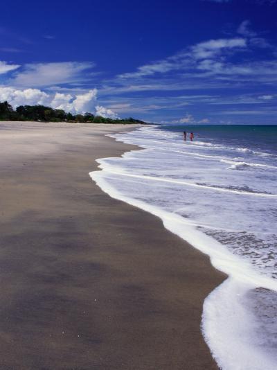 Distant Couple Walking on Beach, Santa Clara, Panama-Alfredo Maiquez-Photographic Print