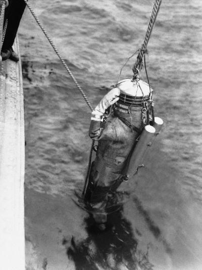 Diver With Two Oxygen Cylinders on Strapped on Back, Being Lowered Into Water-H^ Armstrong Roberts-Photographic Print