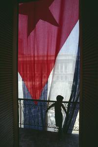 Boy Standing by Cuban Flag by DLILLC