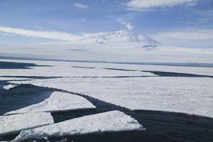 Sea Ice with Mount Erebus in Distance by DLILLC