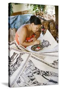 An Artist Works on Traditional Tapa Drawings by Dmitri Alexander