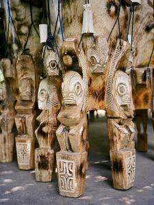 Fierce Tikis Support an Artisan's Drums in the Marquesas Islands by Dmitri Alexander