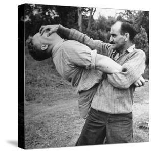 An Instructor Demonstrating a Combat Method by Dmitri Kessel