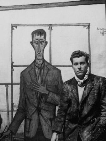 Artist Bernard Buffet Standing Next to a Self Portrait of Himself