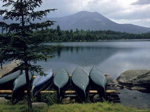 Canoes Turned Bottom Side Up on Shore of Unidentified Lake in Maine by Dmitri Kessel