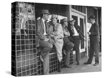 Cattlemen Standing in Front of a Cafe