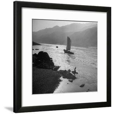 Chinese Junk Boat Sailing Past a Spear Fisherman on the Shore of the Yangtze River