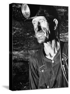 Coal Miner with Head Gear on Working in Mine by Dmitri Kessel
