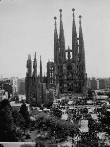 Crowds Gathering Outside the Sagrada Familia Church by Dmitri Kessel