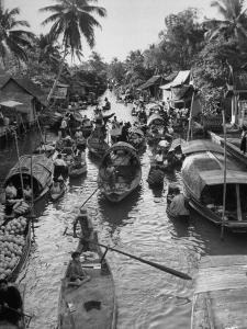 Floating Market in Bangkok by Dmitri Kessel