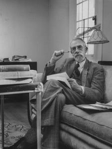 Harvard University Professor Christopher Dawson Sitting in His Study by Dmitri Kessel