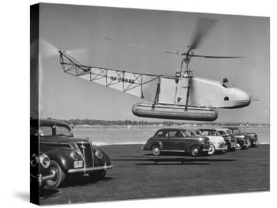 Igor Sikorsky Taking Off in Helicopter from Parking Lot
