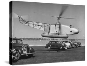 Igor Sikorsky Taking Off in Helicopter from Parking Lot by Dmitri Kessel