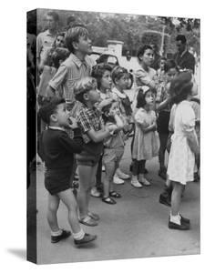 Italian Kids Watching Outdoor Puppet Show by Dmitri Kessel