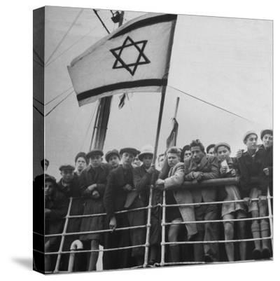 Jewish Immigrants, Arriving in Haifa Aboard Refugee Ship, Waving Future Flag of the State of Israel