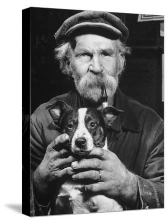 Old Man Holding His Hands around a Dog's Throat