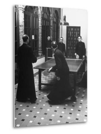 Priests Playing Ping-Pong at Social School