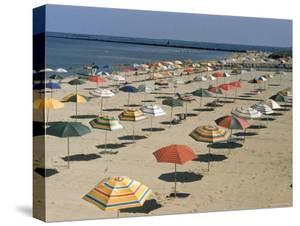 Rows of Open Beach Umbrellas Lining a Sandy Cape Cod Beach by Dmitri Kessel