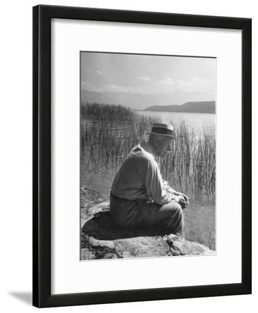 Swiss Psychiatrist Dr. Carl Jung Sitting on Stone Wall Overlooking Lake Zurich