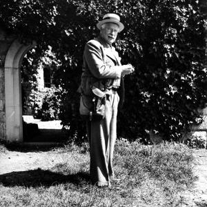Swiss Psychiatrist Dr. Carl Jung Standing in Garden Outside His Home by Dmitri Kessel