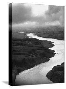 The Congo River Running in Betwenn the Jungle by Dmitri Kessel