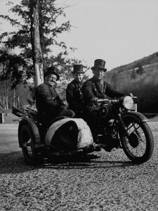 Three Chimney Sweeps Riding a Motorcycle by Dmitri Kessel
