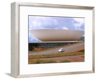 Three Powers Square Building Built by Oscar Niemeyer as Volkwagan drives by
