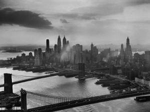 View of New York City Behind the Bridges That are Hovering over the East River by Dmitri Kessel